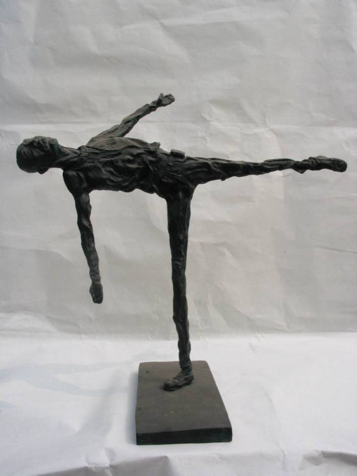 Balancing - a contemporary sculpture of a man balancing one leg by contemporary Chinese sculptor Shen Xiaonan