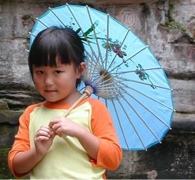 Yezi at Dazu with her blue parasol